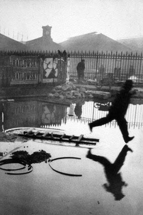 Henri Cartier-Bresson's famous photo Man Jumping the Puddle | 1930